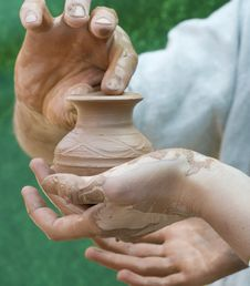 Free Hand Holding Pottery An  Jar Stock Photos - 26346493