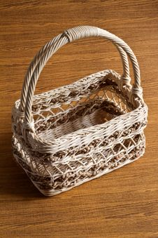 Free Basket On Wood Background Stock Photos - 26346873