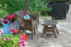 Free Rattan Patio Chair And Table Royalty Free Stock Photos - 26347558