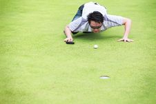 Free Golfer Checking Line Of Putt Royalty Free Stock Photo - 26350685