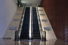 Free Escalator With Art Works On Both Sides Royalty Free Stock Image - 26351776