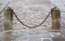 Free Stone Columns With A Chain Stock Photo - 26379720