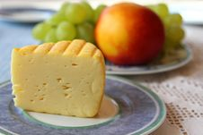 Free Mondseer Cheese With Fruit Background Royalty Free Stock Photo - 26383375