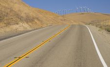 Free Two Lane Road To Wind Power Hill Royalty Free Stock Image - 26383526