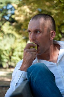Free Man Relaxing In The Park Stock Photo - 26384320