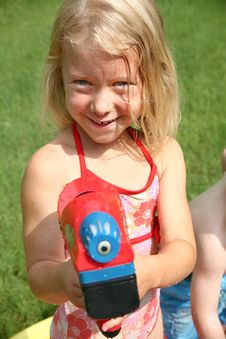 Free Beautiful Girl With Watergun Stock Images - 2642364