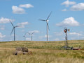Free Old And New Windmills In A Rural Pasture Royalty Free Stock Photo - 26403975