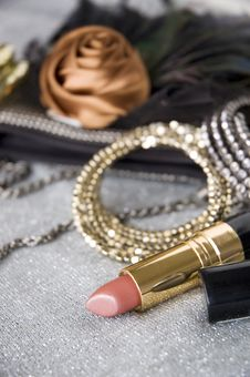 Free Lipstick And Accessories Stock Image - 26400941