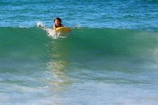 Free Surfing Girl On A Wave Stock Photo - 26401580