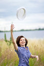 Free Happy Young Woman With Hat In Air Royalty Free Stock Photography - 26413317