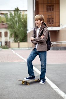 Free School Teen With Schoolbag And Skateboard Stock Image - 26410691
