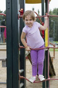 Cute Girl At Playground Stock Photos
