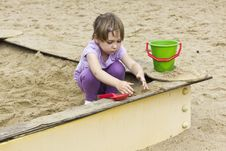 Free Cute Girl At Sandbox Stock Photography - 26411302