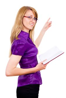 Free The Girl Keeps A Book And Indicates Stock Photography - 26412512