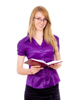 Free The Girl Keeps A Book And Indicates Stock Photo - 26412560