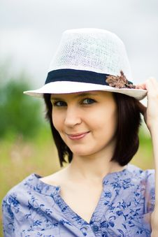 Beautiful Young Brunette Woman In Straw Hat Royalty Free Stock Photo