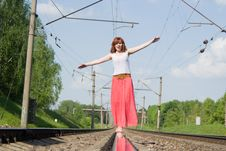 Beautiful Girl Standing On The Rails Stock Images