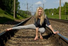 Free Girl Blonde Sitting On The Rails Royalty Free Stock Image - 26414136