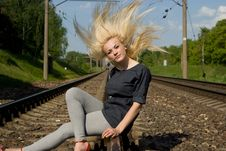 Free Girl Blonde Sitting On The Rails Royalty Free Stock Photography - 26414157