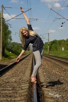 Free Blonde Girl Goes On Rails Royalty Free Stock Photo - 26414235