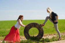Free Two Girls Rolls Wheel Royalty Free Stock Photo - 26415935
