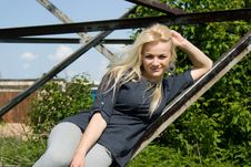 Free Beautiful Blonde Girl Lies On A Construction Site Stock Photo - 26416060