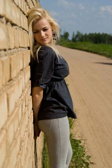 Free Beautiful Blonde Girl Is Standing Against The Wall Stock Photo - 26416460