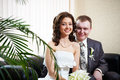 Free Happy Bride And Groom Sitting Together Royalty Free Stock Photography - 26421387