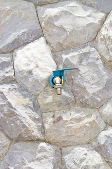 Free Faucet On The Background Wall Stone Royalty Free Stock Images - 26427049