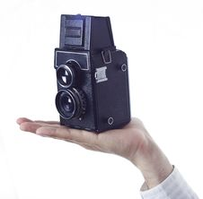 Free Hand With Retro Camera Royalty Free Stock Photography - 26427187