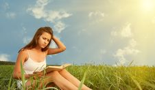 Free Girl Reading A Book On Nature Royalty Free Stock Photography - 26441327