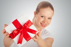 Beautiful  Woman With A  Gift With Red Ribbon Royalty Free Stock Photo
