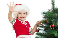 Free Pretty Preschool Child Decorating Christmas Tree Stock Photography - 26447482