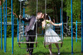 Free Romantic Kiss Bride And Groom On Swing Royalty Free Stock Images - 26466499