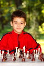 Free Boy Playing Chess Outdoor Royalty Free Stock Photography - 26467767