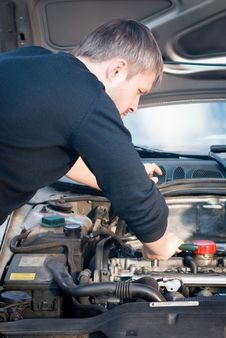 Young Man Fixing His Car Royalty Free Stock Images