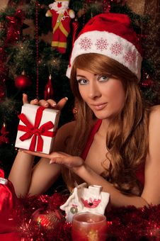 Free Santa Helper With Present Under Christmas Tree Stock Photo - 26470780