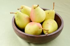 Yellow Pears In Old Wooden Bowl Stock Photos