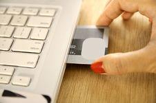 Free Credit Card Insert Inside Laptop Royalty Free Stock Image - 26476696