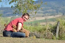 Free Young Man Playing With Dog In Countryside Stock Image - 26478691
