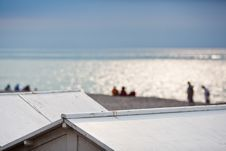 Free View Over Beach Hut Roofs To The Beach Royalty Free Stock Photos - 26480968