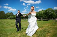 Happy Groom And Happy Bride On Wedding Walk Stock Images