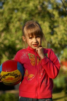 Fun In The Garden With Ball Royalty Free Stock Photo