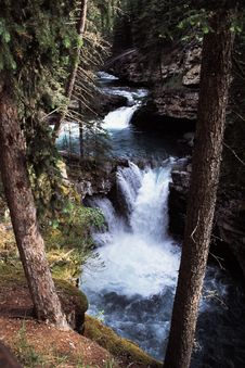 Falls In Wooded Canyon Royalty Free Stock Photography