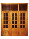 Free Closed Natural Wooden Triple Door Royalty Free Stock Photo - 26500855