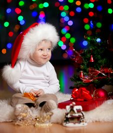 Funny Baby Santa Claus On Bright Background Royalty Free Stock Images
