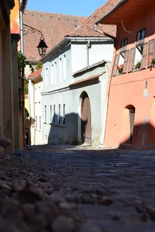 Free Paved Street With Old Houses In Sighisoara Royalty Free Stock Photography - 26540707