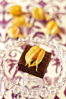 Free Chocolate Brownie On A Glass Cake Stand Royalty Free Stock Images - 26554449