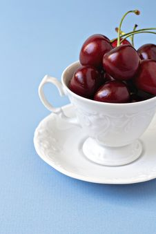 Sweet Cherries In A White Cup Stock Photos