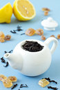 Free Small Tea Pot With Leaves Of Black Tea Stock Image - 26569911